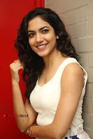 Actress Ritu Varma Stills in White Floral Short Dress at Kesava Movie Success Meet .COM 0115.JPG