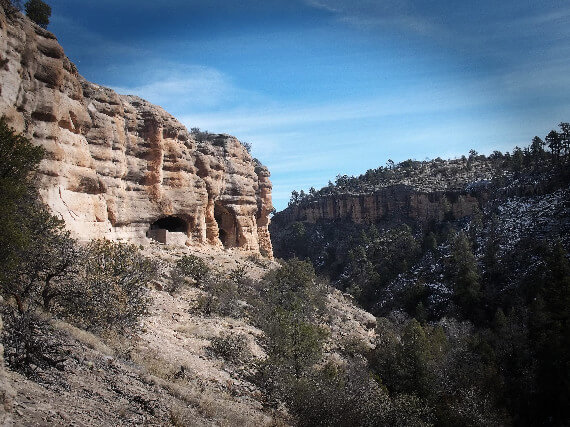 View of Gila Cliff Dwellings National Monument, New Mexico, from west. They're a perfect survivalist prepper fortress when SHTF. – vanholio.com