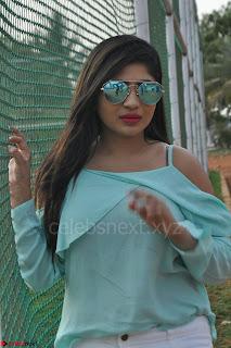 Madhulagna Das looks super cute in White Shorts and Transparent Top 04.JPG