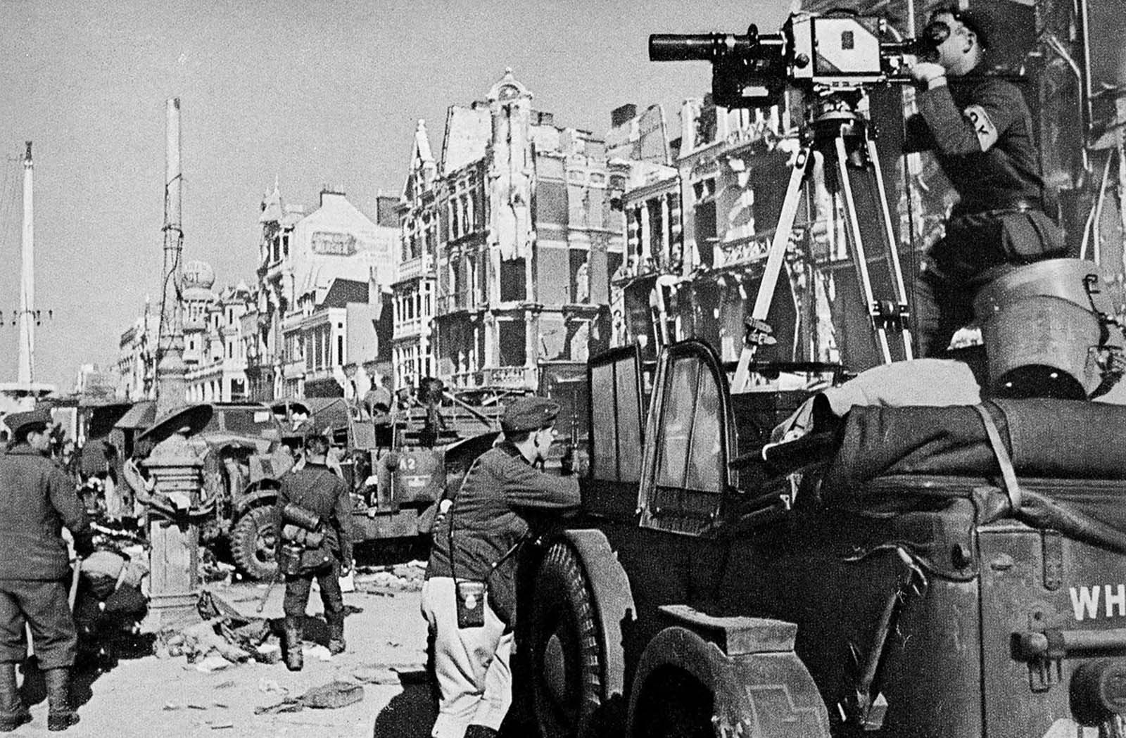 A German cameraman records the departure of the last Allied troops from Dunkirk.