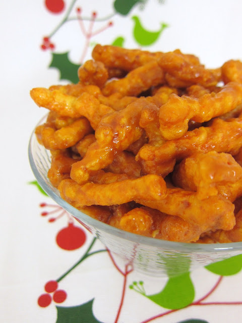 Caramel Cheetos - crazy good! Only 5 ingredients! You won't be able to stop eating these! Cheetos tossed in brown sugar, butter, corn syrup and baking soda. Sounds weird, but they are OH SO GOOD!