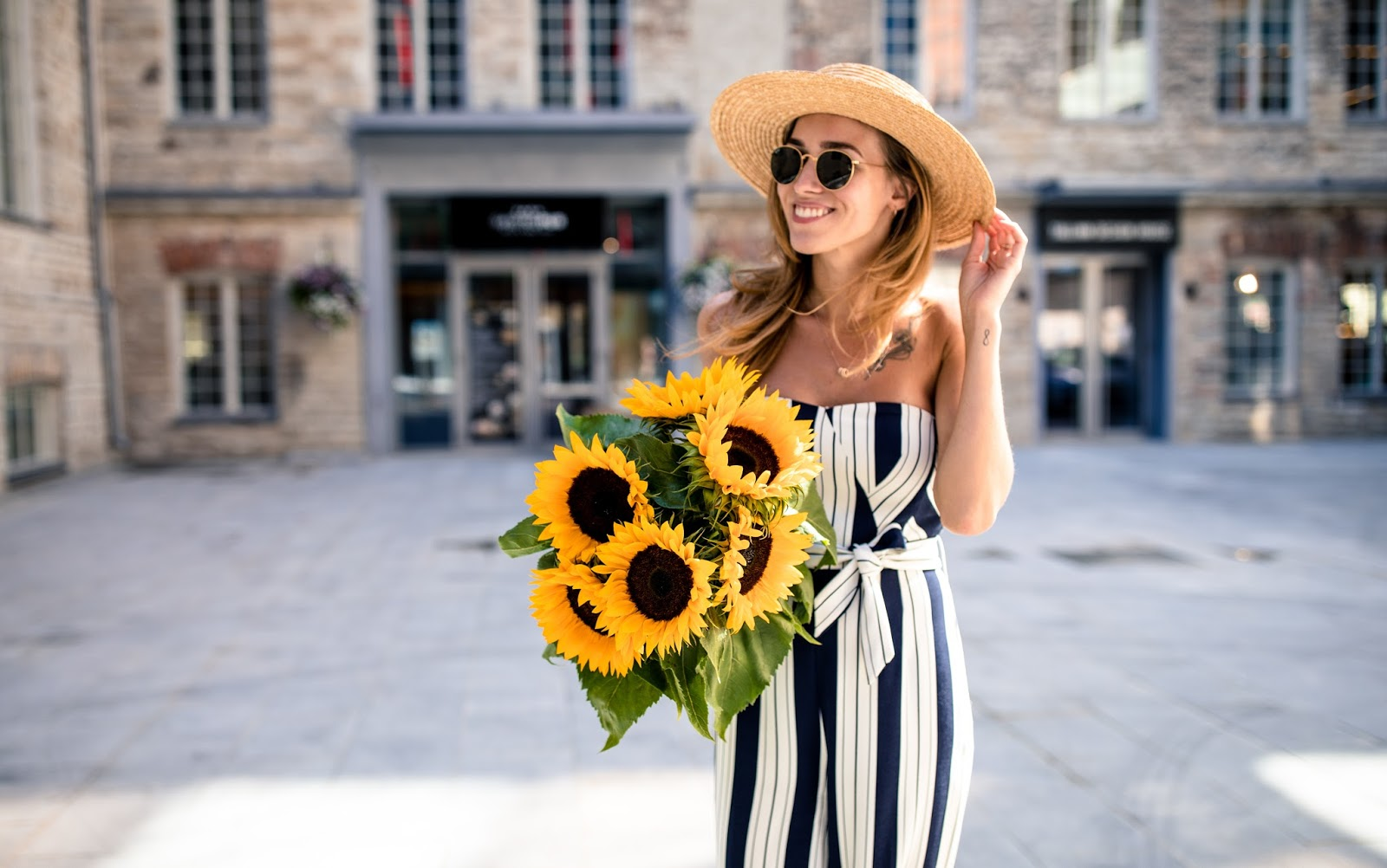 girl sunflowers straw hat striped jumpsuit