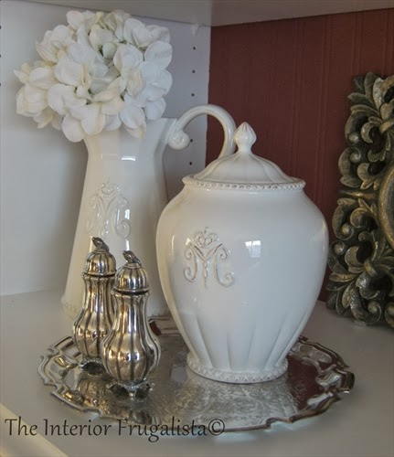 Silver scalloped plate and salt & pepper shakers to create a pretty vignette