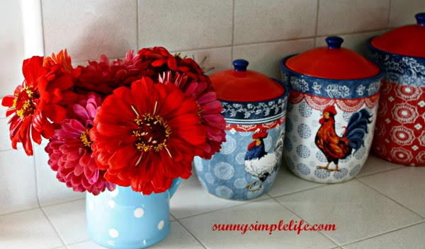 zinnias in vase, chicken canisters