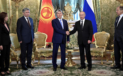Vladimir Putin and Almazbek Atambayev.
