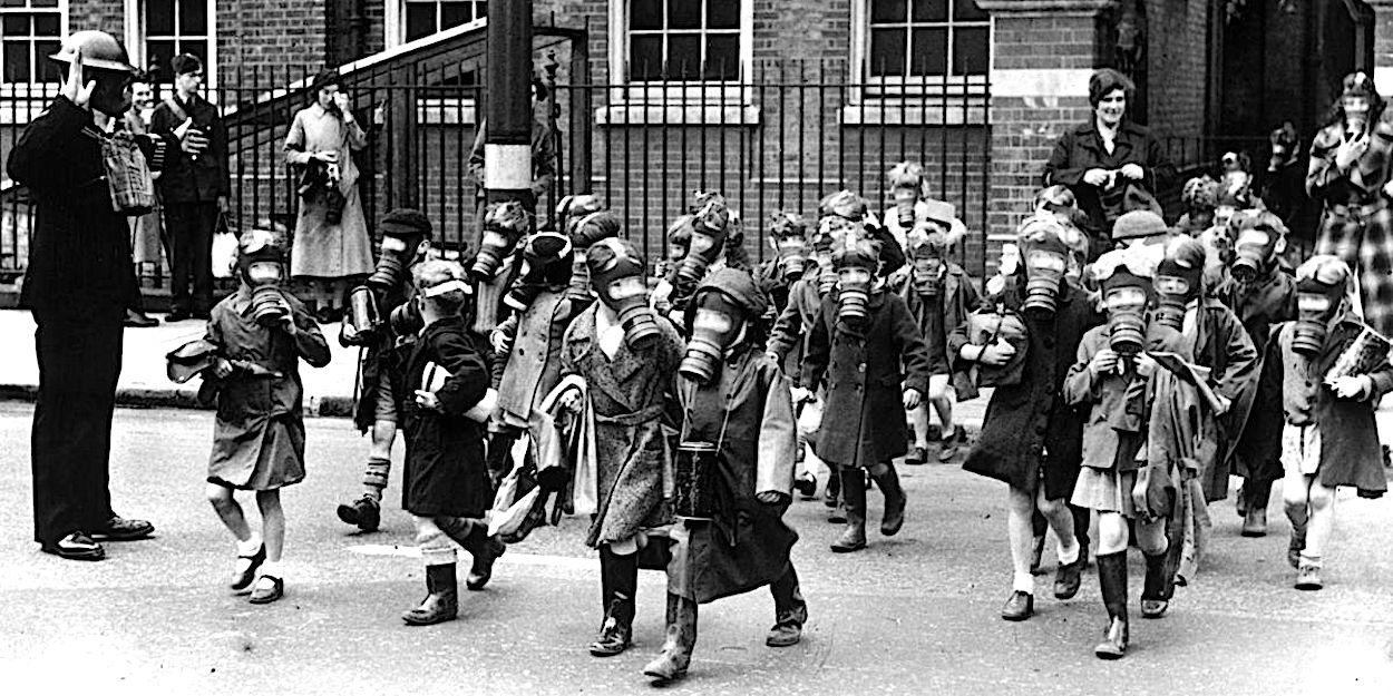 WW2 child evacuees wearing gas masks
