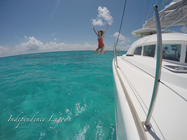 Lucy jumps off a Lagoon 380 sail catamaran in the Florida Keys