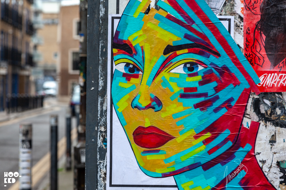 French Street Artist Manyoly colourful female portrait  pasteups