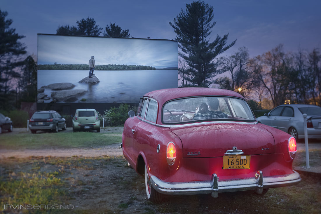 A couple snuggles together in a vintage red car at the drive in movie theater in Saco, Maine.