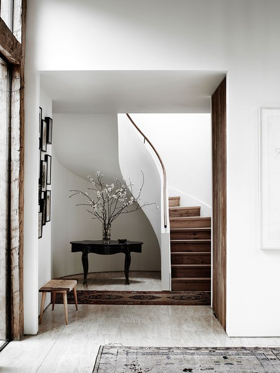 Peaceful tranquil entry way with wood staircase and quiet colors - found on Hello Lovely Studio