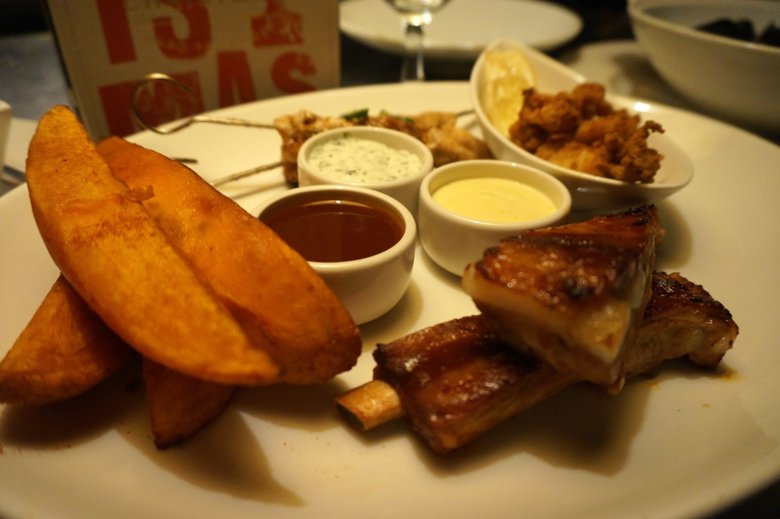 Honey glazed chicken skewers, salt and pepper calamari, BBQ ribs and baked sweet potato wedges.