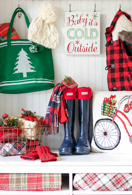 Whimsical Christmas mudroom with lots of color, plaid and presents