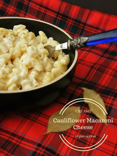 A bowl of Creamy Cauliflower Macaroni Cheese on a red tartan placemat
