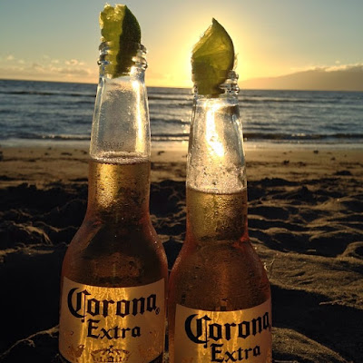 Corona beers with lime wedges on the beach