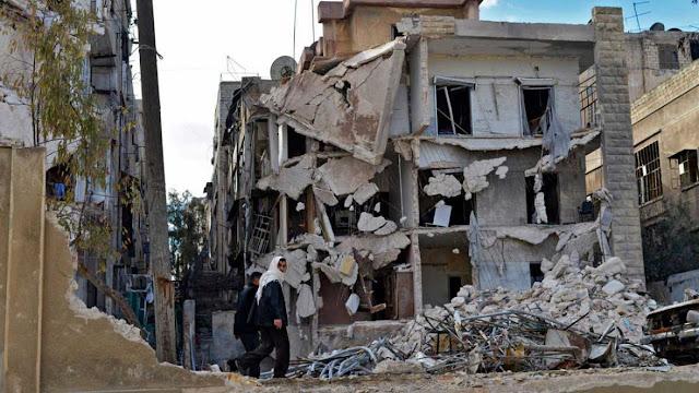 Edificio destruido en Alepo en febrero de 2014. EFE ALI MUSTAFA