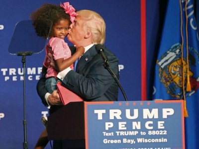 (Video) Bring her she is so beautiful- Donald Trumps kisses young girl during Wisconsin rally