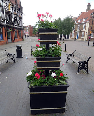 Brigg in Bloom town centre planters containing colourful flowers in 2018