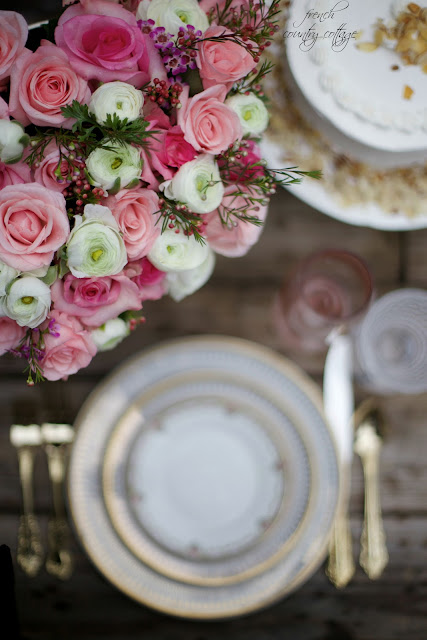 Flowers and gold dishes on a rustic table top
