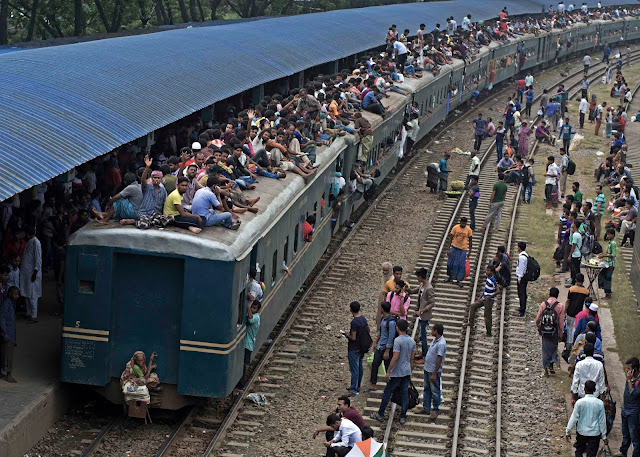 Bangladeshi Muslims Ride Home To Celebrate Eid by Train