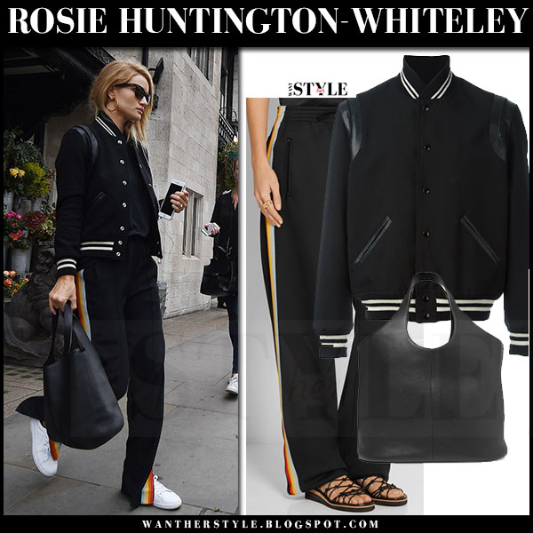 Rosie Huntington-Whiteley in black saint laurent teddy bomber jacket and black side panel track pants chloe what she wore london fashion week