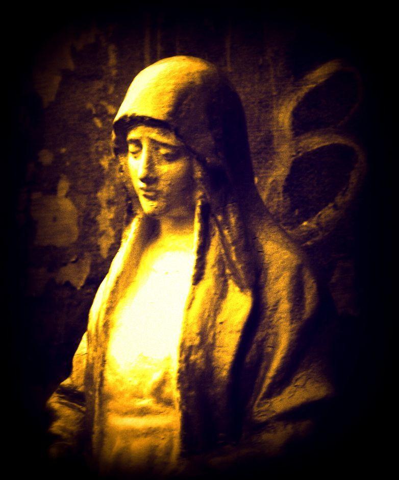 A statue of a saint inside La Loma Cemetery
