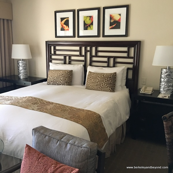 guest room bed at Tradewinds Carmel in Carmel, California
