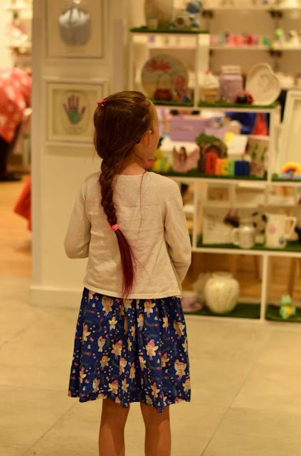 Girl in Emily's Paint a Pot in Next, Manchester Arndale