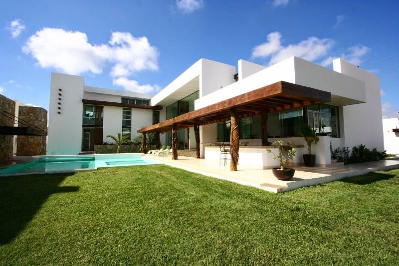 Casa los troncos punto arquitect nico tecno haus for Casas prefabricadas de diseno minimalista