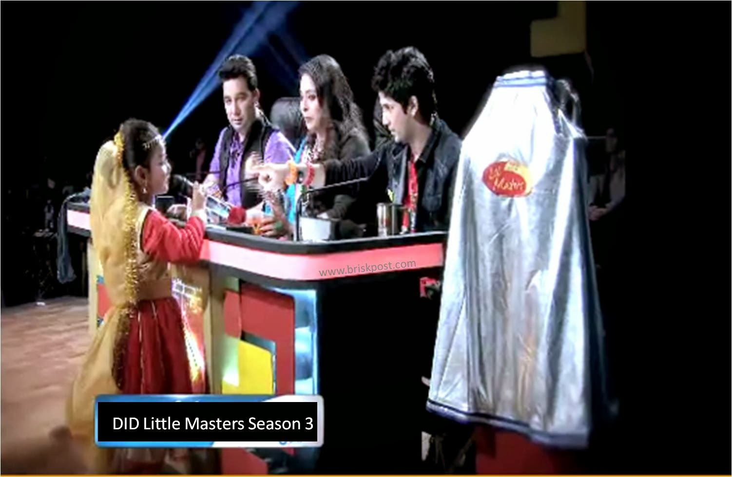 Master Ahmad, Geeta Ma and Master Mudassar interacting with a little girl on DID Little Masters; on right-hand-side, the Super Wing is shining to inspire the contestants