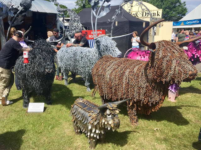 Highland cow sculptures at the Royal Highland Show, Edinburgh, Scotland