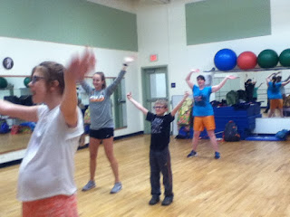 Four students doing Zumba