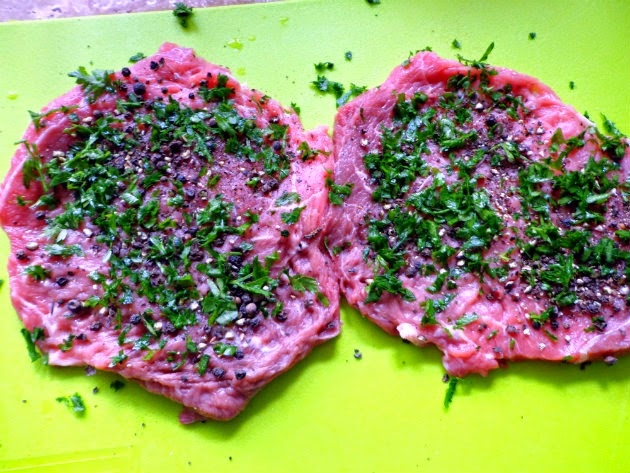 press parsley and cracked pepper into beef
