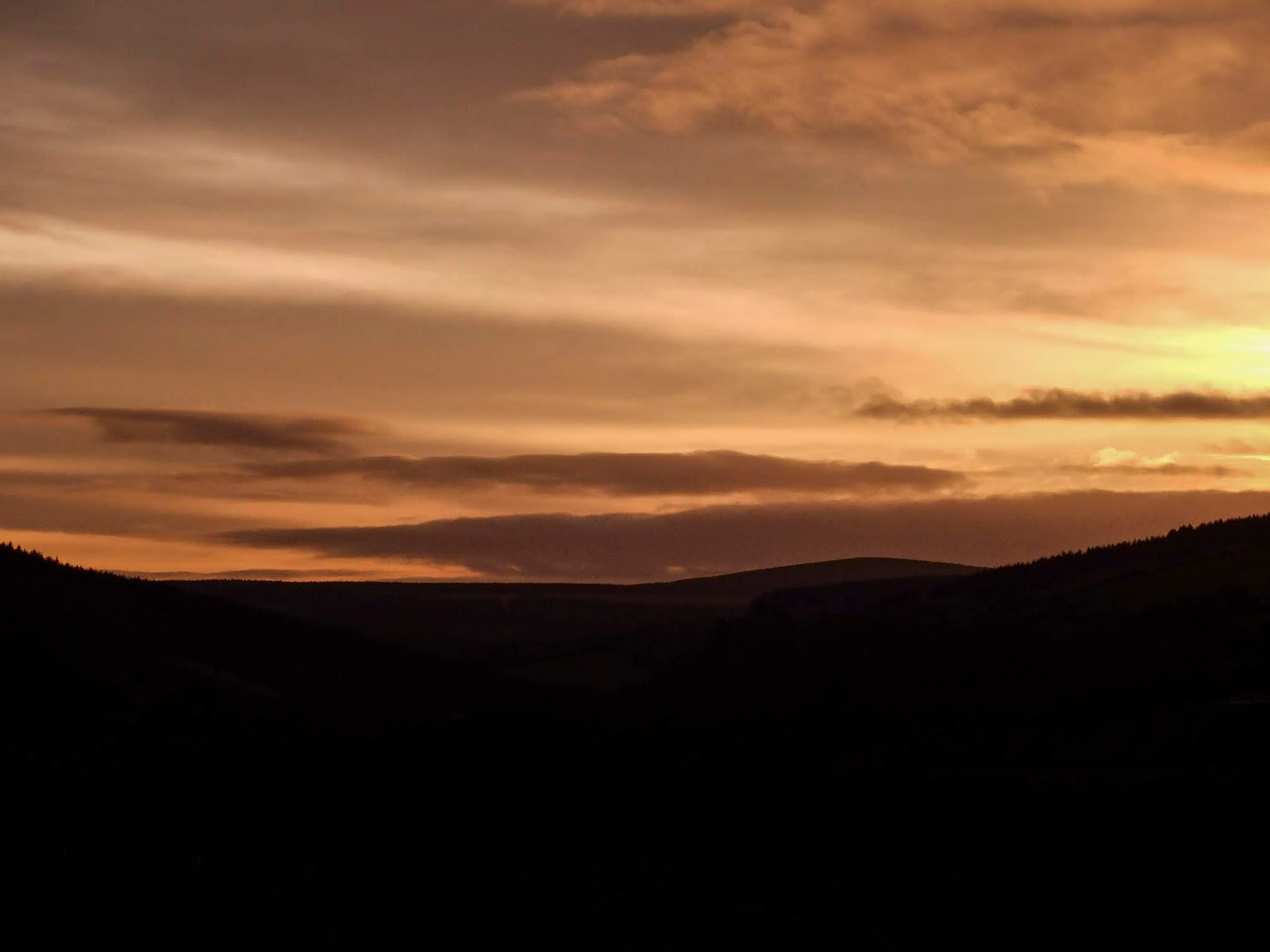 Sunset over a mountain landscape of North Cork.