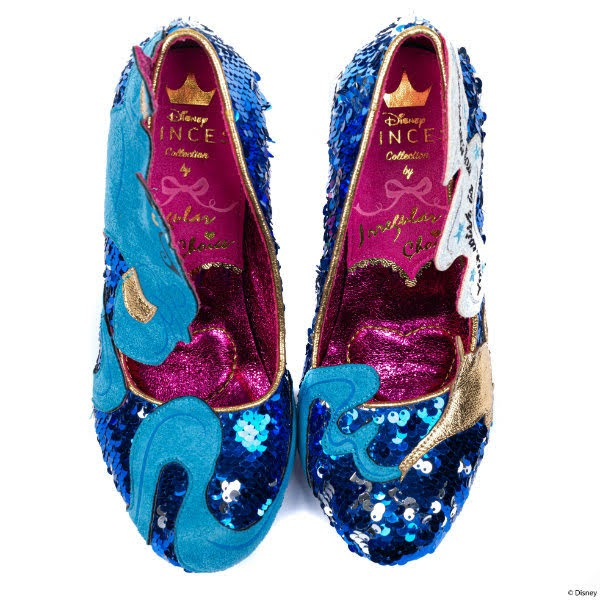 blue sequined shoes from above showing pink lining and genie figure coming from magic lamp applique