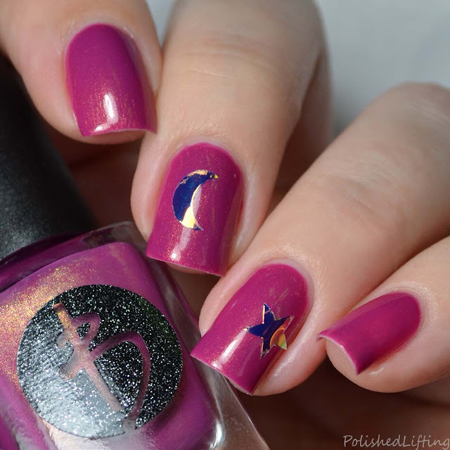 berry nail polish with nail art stickers