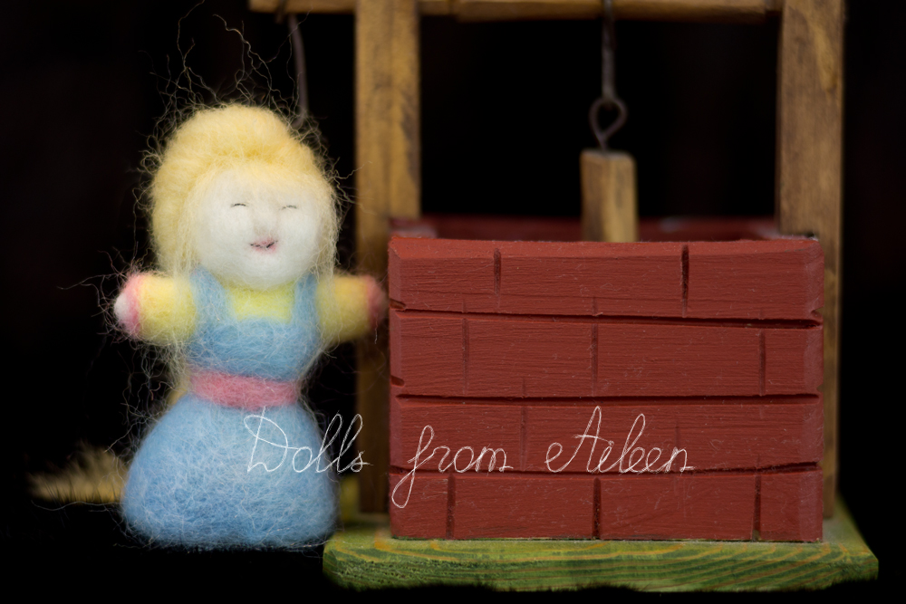OOAK needle felted woman doll standing next to well