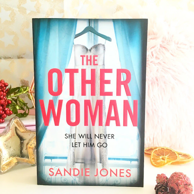 The Other Woman book in front of candles, autumn props