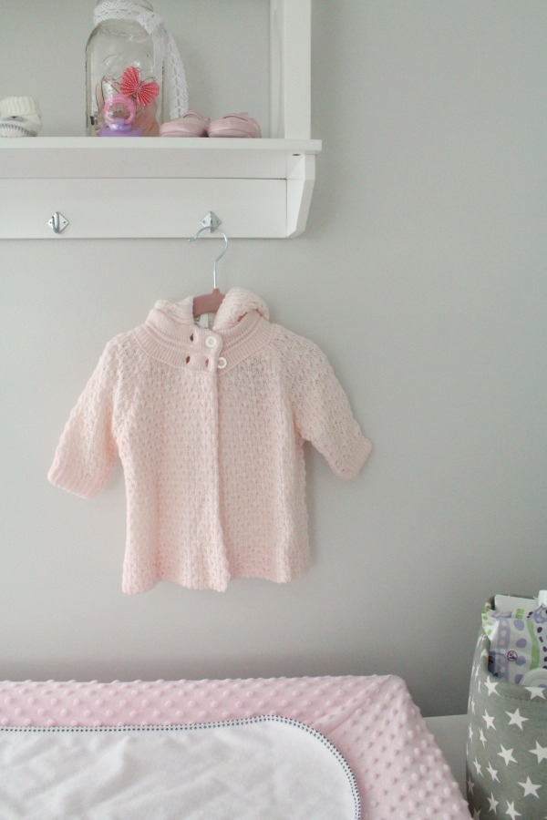 Gray white and light pink nursery for a baby girl- changing table