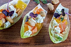 Cara Cara Oranges, Marcona Almonds & Goat Cheese Endive Leaves w/ Sherry Vinaigrette