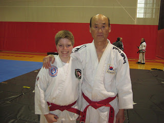 Colorado martial arts red belt with grandmaster bong yul shin