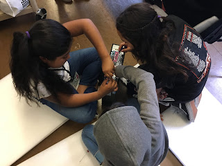 Students take apart a desktop computer in the Tech Chicxs club at Buena Vista Horace Mann K-8.