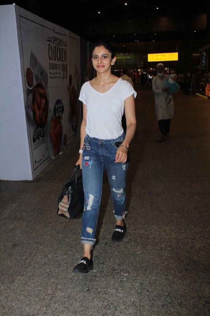 Rakul Preet Singh Stills In White Top Tight Blue Jeans at Airport