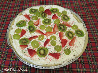 Blog With Friends, a multiblogger collabortive post based on a theme. This month's theme is Warm and Cozy | Kayla of That One Birch shares A Very Merry Fruit Pizza. | shared on www.BakingInATornado.com | #BlogWithFriends