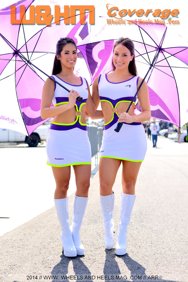 Arley Elizbabeth and Chanel Urban the umbrella girls for Achilles Tires at 2014 Formula Drift Irwindale in their miniskirts and white knee high boots