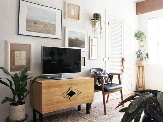 Don't want your t.v. to be a focal point? Flank it with art/gallery wall style- design addict mom