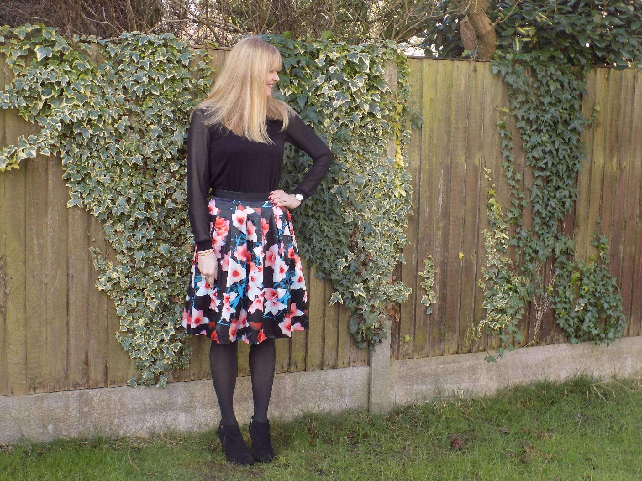 Satin floral skirt with opaque tights and ankle boots