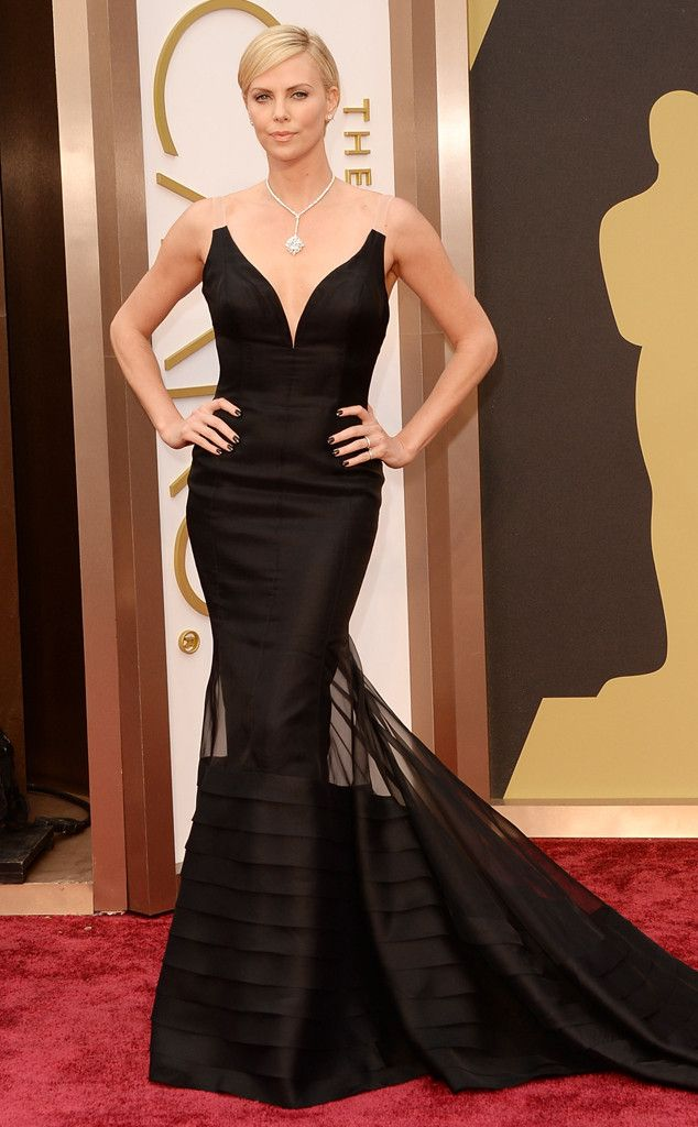 Charlize Theron in a black mermaid Dior gown at the Oscars 2014