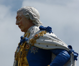 Close up view of the head of the Coade stone  statue of George III, Weymouth seafront © A Knowles