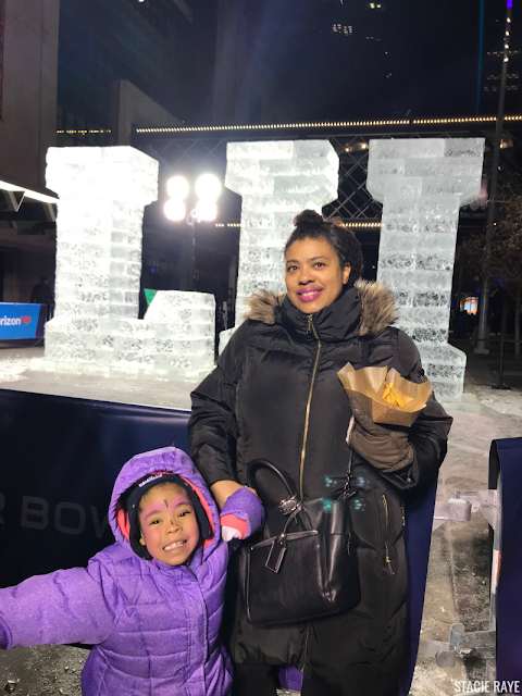 a woman and child at Minneapolis Super Bowl 52 Festivities