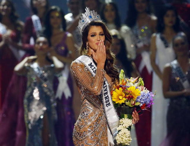 Iris Mittenaere of France blows kisses to the crowd after being proclaimed the new Miss Universe 2016